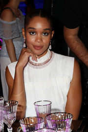 Laura Harrier matched her earrings with a dazzling collar necklace.