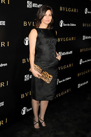 Gina Gershon donned black suede crisscross heels with a fitted brocade shift.