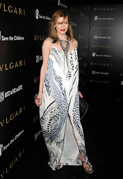 Milla added a sultry edge to her Bohemian dress with metallic platform sandals.