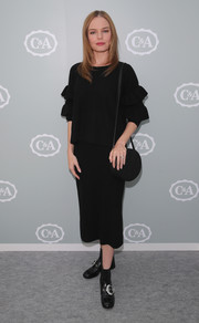 Kate Bosworth donned a black sweater with ruffled sleeves for the C&A Collection Room event.