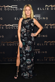 Ellie Goulding's Versus Versace floral maxi dress at her Art Basel performance looked deceptively demure from the front, but wait until you see that hip-high slit and open back!