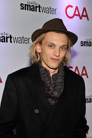 Jamie Campbell Bower spiced up his coat with a skull-print scarf.