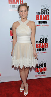 Kaley Cuoco defied the winter season in a lacy cream dress paired with puzzling white peep-toes.