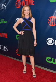 Marg Helgenberger went for a youthful, modern vibe at the CBS Summer TCA Party in a black dress with a crisscross bodice and electric-blue piping.