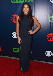 Gina Rodriguez completed her simple ensemble with a matching high-slit maxi skirt.