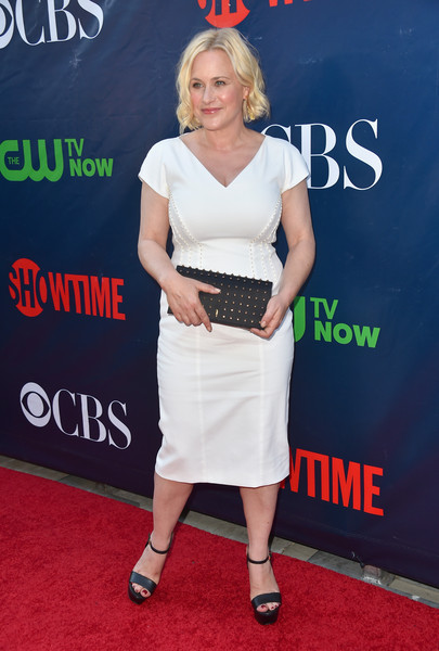 Patricia Arquette styled her LWD with a studded black clutch.