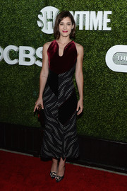 Lizzy Caplan hit the CBS Summer TCA Party wearing a Roland Mouret frock featuring a burgundy velvet bodice and a monochrome printed skirt.