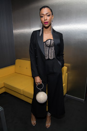 Sonequa Martin-Green looked sharp in a black wide-leg pantsuit teamed with a chain bustier at the Eye Speak Summit.