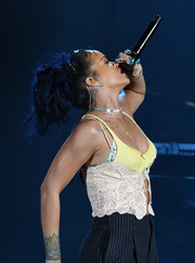 Rihanna added an extra pop of color with her metallic blue mani.