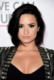 Demi Lovato highlighted her peepers with vampy cat-eye makeup.