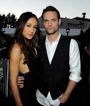 Shane West spruced up a simple white button-down shirt with a spiffy black vest.