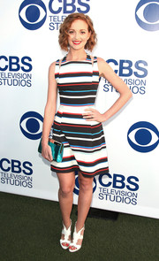 Jayma Mays completed her perky ensemble with a metallic blue Jimmy Choo clutch.