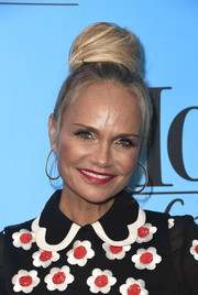 Kristin Chenoweth attended the 'Mom' 100 episodes celebration wearing her hair in a huge bun.