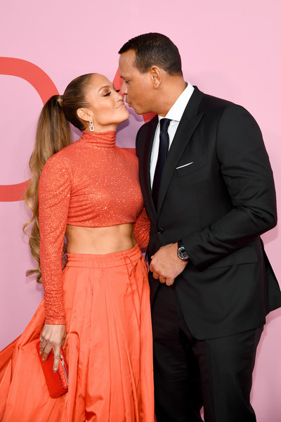 Jennifer Lopez teamed an orange crystal clutch by Judith Leiber with a crop-top and a maxi skirt for the 2019 CFDA Fashion Awards.