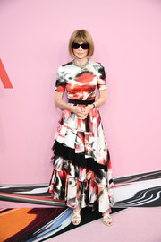 Anna Wintour looked vibrant in a printed maxi dress with a tiered skirt at the 2019 CFDA Fashion Awards.