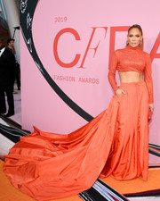 Jennifer Lopez showed off her rock-hard abs in an orange turtleneck crop-top by Ralph Lauren at the 2019 CFDA Fashion Awards.