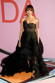 Kat Graham went for flirty glamour in a strapless black corset gown by Oscar de la Renta at the 2019 CFDA Fashion Awards.