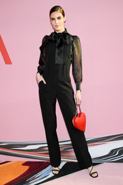 Hilary Rhoda styled her look with strappy black heels.