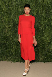 Lily Kwong kept it simple yet lovely in a red peplum dress during the Fashion Fund finalists celebration.
