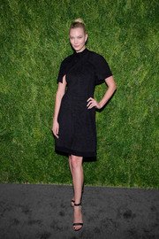 Karlie Kloss polished off her look with a pair of black ankle-strap sandals by Gianvito Rossi.