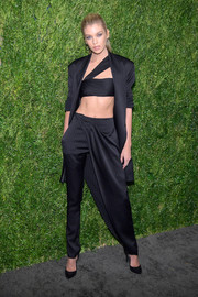Stella Maxwell looked uber cool in this black jacket, crop-top, and pant-skirt combo by Baja East at the CFDA/Vogue Fashion Fund 15th anniversary event.