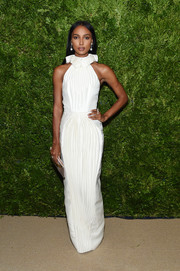 Jasmine Tookes looked charming in a pleated white Azzi & Osta Couture gown with a ruffled neckline at the 2019 CFDA/Vogue Fashion Fund Awards.