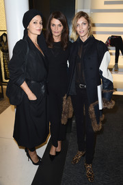 Anja Rubik teamed her coat with black skinny jeans and a sheer blouse.
