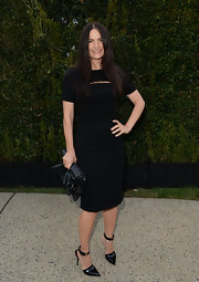 Rosetta Millington wore a capped-sleeve black dress with a horizontal cutout detail at the neck.