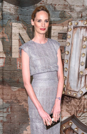 Lauren Santo Domingo paired a metallic box clutch with a silver dress for the Chanel dinner.