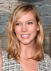 Karlie Kloss finished off her look with a delicate diamond tennis necklace and matching studs.