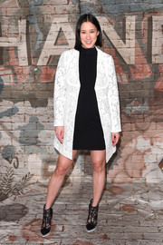 Eva Chen layered a white lace coat over an LBD for her Chanel dinner look.