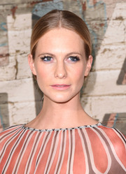 Poppy Delevingne chose a sleek chignon for a dinner hosted by Chanel.