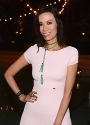 Wendi Deng had a branch ring wrapped around her middle finger at Chanel's dinner auction.