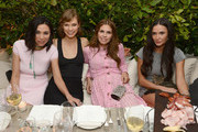 Wendi Murdoch, model Karlie Kloss, Dasha Zhukova and actress Demi Moore attend a dinner and auction hosted by CHANEL to benefit the Henry Street Settlement at Soho Beach House on December 5, 2012 in Miami Beach, Florida.