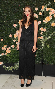 Sophie Auster was chic in a black lace jumpsuit at the Chanel party in LA. She accessorized the look with black patent leather platform pumps.
