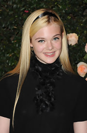 Elle Fanning wore her long hair ultra straight with a sweet ribbon headband at the Chanel boutique in Los Angeles.