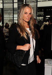 Molly Sims showed off a cool woven shoulder bag while hitting the Chanel Soho boutique re-opening.