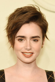 Lily Collins teased her short hair into this messy-chic style for the Chanel Paris-Salzburg show.