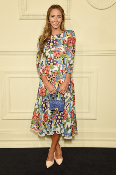 Harley Viera-Newton paired her lovely dress with a blue woven-leather purse, also by Chanel.