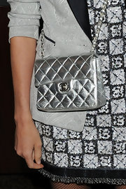 Amanda Brooks attended the Chanel dinner donning a cool metallic shoulder bag from the designers newest collection.