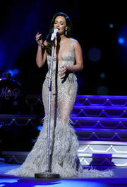 Kacey Musgraves dropped jaws with this beaded and feathered mermaid gown at the CMA 2016 Country Christmas.