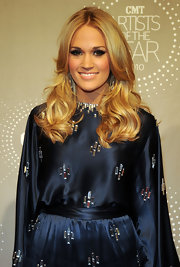 Carrie Underwood showed off her radiant layered tresses while attending the CMT Artist of the Year event.