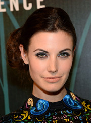 Meghan Ory styled her hair into a curly side bun for the 'Intelligence' premiere party.