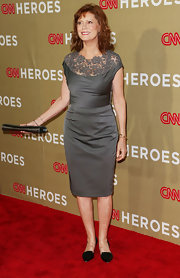 Susan Sarandon showed off her curves in the gray satin cocktail dress with an elegant lace neckline.