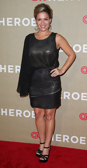 Cat Cora strutted down the red carpet of the CNN Heroes event in an iridescent single-sleeved cocktail dress.