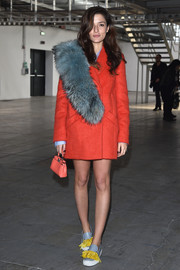 Eleonora Carisi kept it fun all the way down to her feather-embellished slip-ons.
