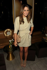 Lauren Conrad looked demure carrying a classic beige Chanel bag.