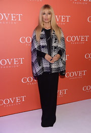Rachel Zoe mixed a classic cape silhouette with her signature boho style at the Covet fashion launch event.
