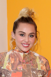 Miley Cyrus swept her hair up into a mildly messy top knot for the world premiere of 'Crisis in Six Scenes.'