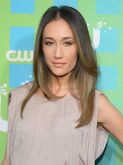 Maggie Q wore her hair in a center part with a hint of a feathered flip during CW Network's New York 2012 Upfront.
